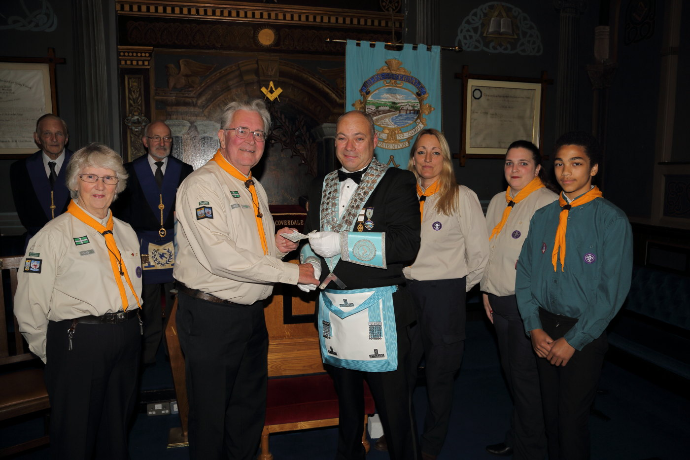 Worshipful Master W.B. Colin McVicker presents a cheque to David Johnson of the 15th Torbay (Belgrave) Scouts