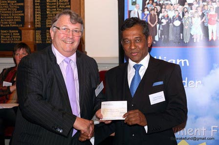 R.W. Bro. Ian Kingsbury ProvGM presents cheque to Georges Adroit (right) from Torbay Hospital League of Friends